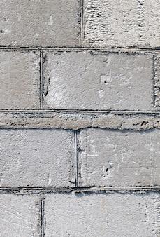 오래된 가스 규산염 블록에서 회색 벽의 일부, 건물