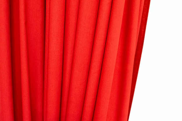 Part of  red curtain isolated on white backdrop