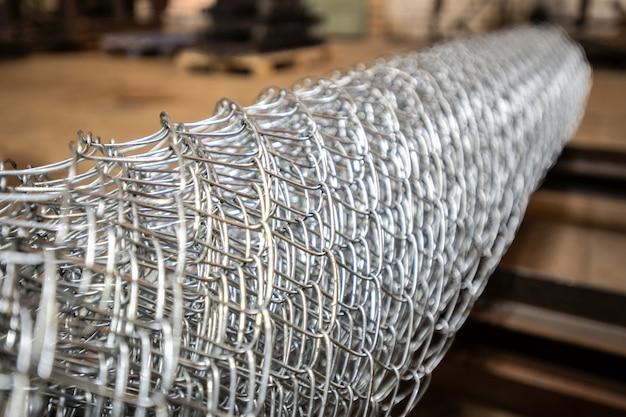 Part of rolled metallic industrial net used in heavy industry