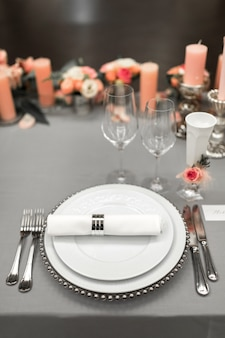 Part of stylish table setting with plate and cutlery.
