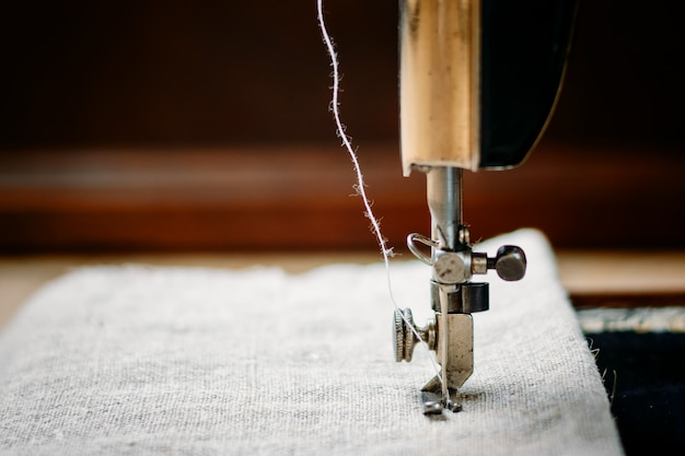 Part of a vintage sewing machine and item of clothing.