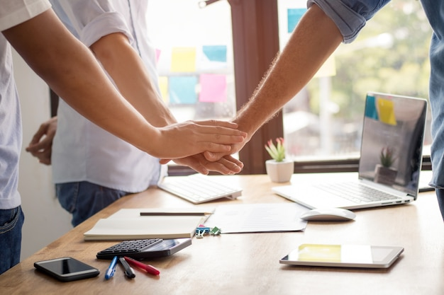 Parthnership and teamwork concept, businessman take hand coordination over table