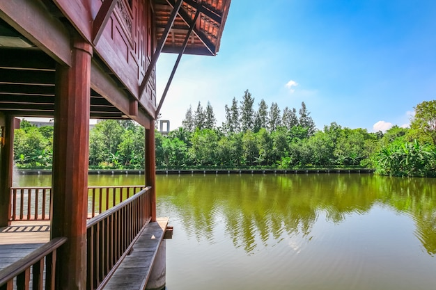 Partial of old style  thai house on the river with blue sky