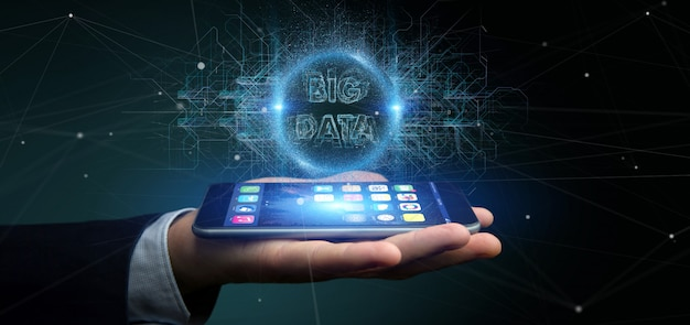 Particles big data title holding by a businessman