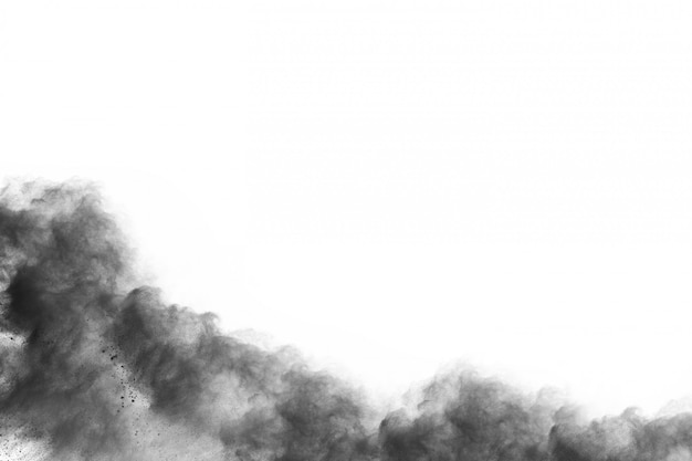 Particles of charcoal on white background,abstract powder splatted on white background.