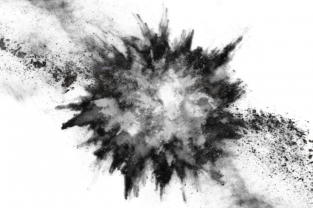 Particles of charcoal on white background.
