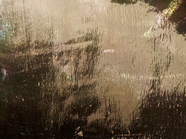 Particles of gold on wet background
