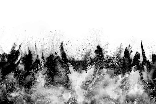 白い背景の上の木炭の粒子