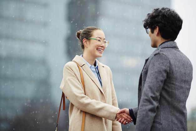 Partners handshaking
