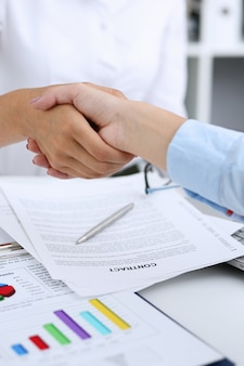 Partnership agreement closeup with man in suit