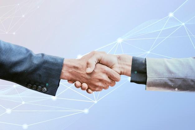 Concetto di business aziendale dell'innovazione della stretta di mano di partnership