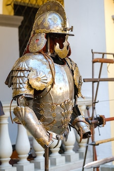 Parts of ancient knight's armor.a medieval concept.metallic texture. Premium Photo