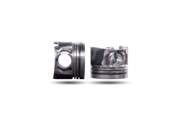 Parts of car piston isolated on white surface