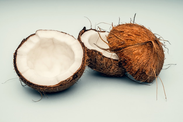 Parts of coconut. close up. fresh ripe coconut broken into pieces.