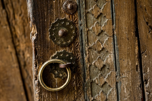 Parts and elements of the old antique wooden door with a handle