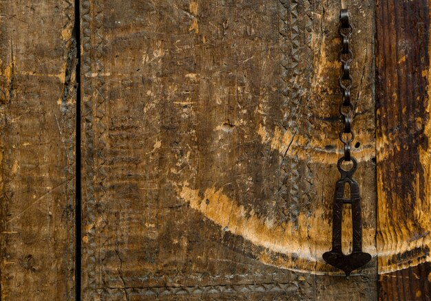 Parts and elements of the old antique wooden doors with chain