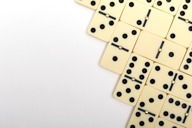 Parts of game of domino on white with copy space for text. domino background.