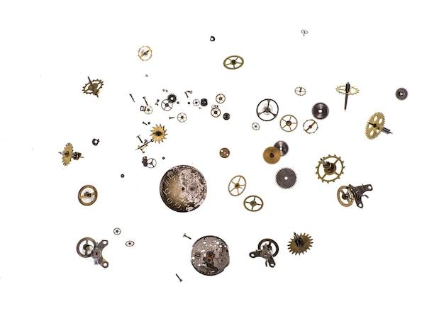 흰색 배경에 시계 메커니즘의 부품