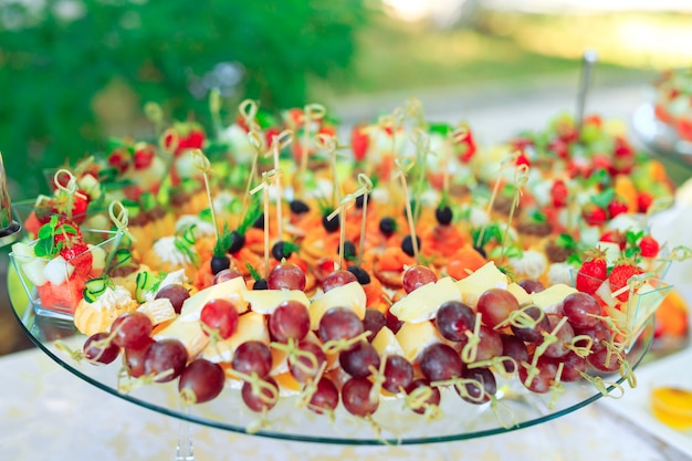 Party appetizers on wooden sticks