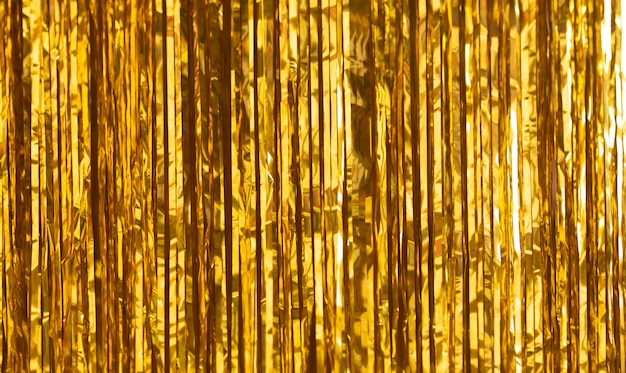 Party background. decor made of gold foil, tinsel and candy.