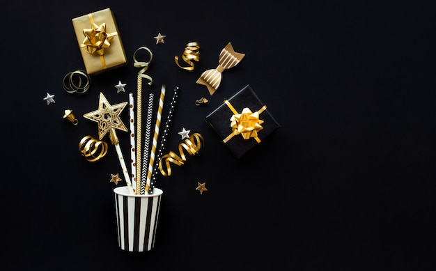 Party and celebration with golden prop and ornament on dark color background.flat lay design
