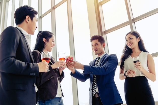 Party concept business men holding gift box give to businesswomen