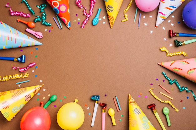 Party decoration items with space for writing text on brown background