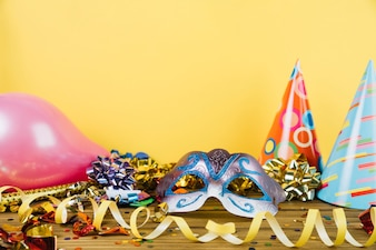 Party decoration material with masquerade carnival feather mask and balloons