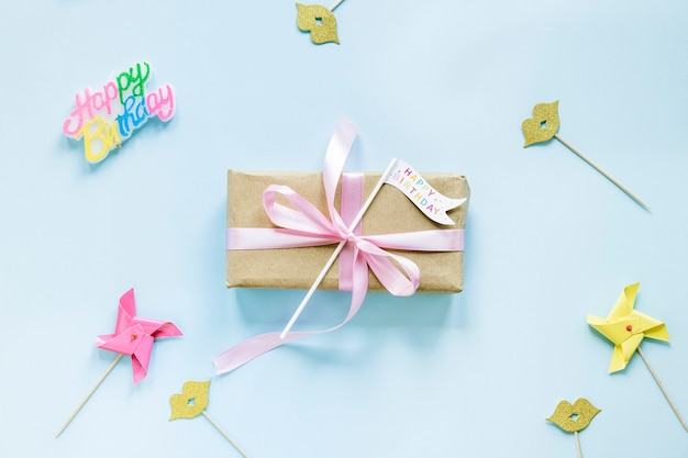 Party decorations around gift box