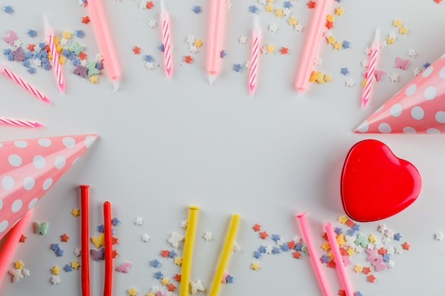 Party decorations with sugar sprinkles, gift box on a white table