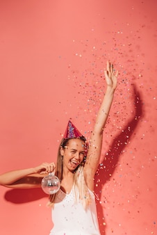Party girl posing with confetti