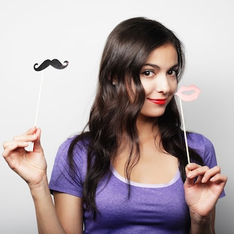 Party image. playful young woman ready for good time.