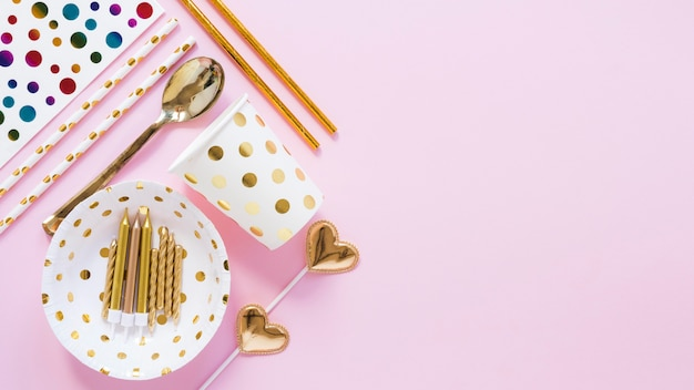 Party items on pink background above view
