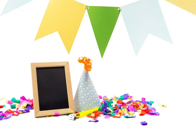 Party items with hat, confetti and a photo frame