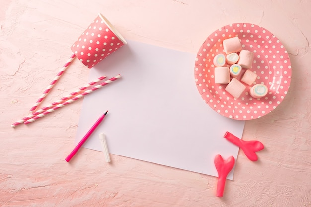 Party management and organization concept with sweets, confetti and blank pages