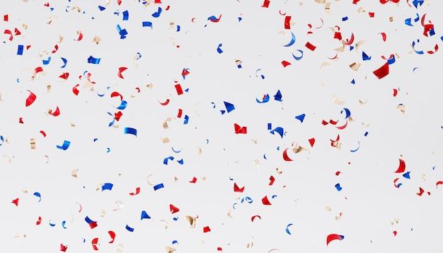 パーティーやお祝いの休日の背景、赤、青、金色の紙吹雪、3dレンダリング