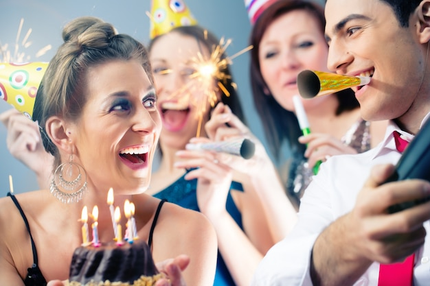 Party people in bar celebrating birthday