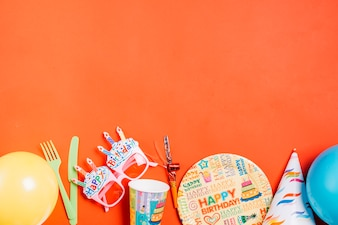 Party supplies on orange background