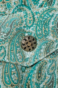 Pasley pattern dress with button close-up
