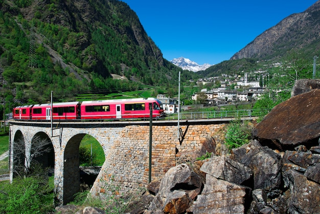 Passage to brusio helicidal viaduct of the bernina red train Premium Photo