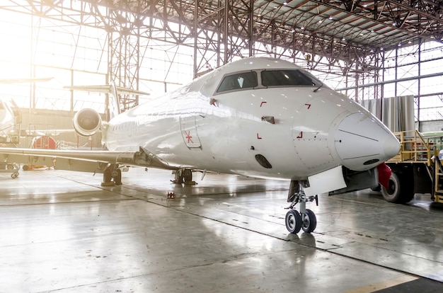 Passenger aircraft in the hangar on service.