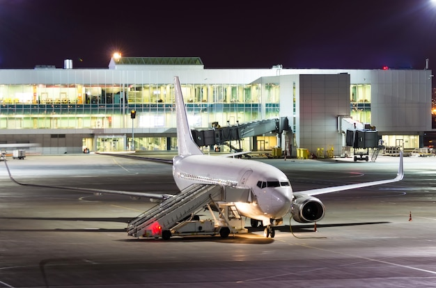 Passenger aircraft parked at night at the airport.