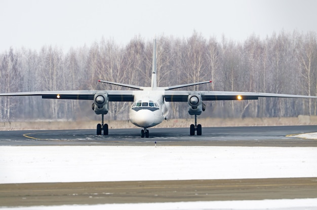 Passenger airplane on the airfield winter before takeoff.