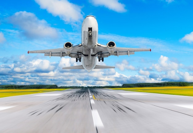 Passenger airplane fly up over take off runway from airport.