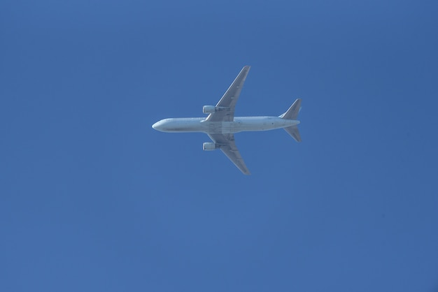 Passenger airplane flying over blue sky