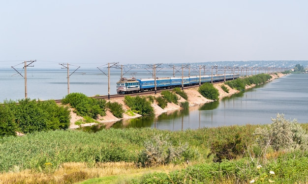Passenger electric train passes the dnieper river in ukraine