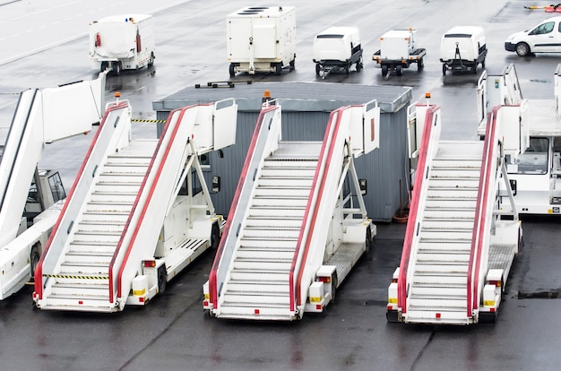 Passenger ladders for boarding passengers in an airplane.