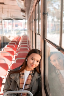 Passenger listening to music in the tram