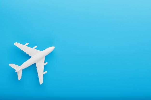 Passenger model airplane on a blue background