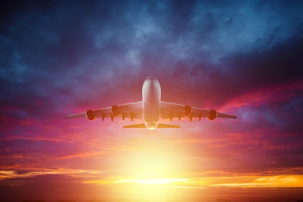 Passenger plane, airliner flies against  a beautiful sunset. travel concept, air travel. copy space.